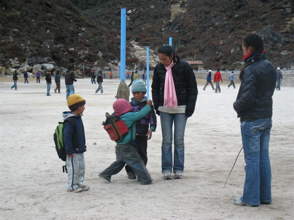 Local school kids play in snow