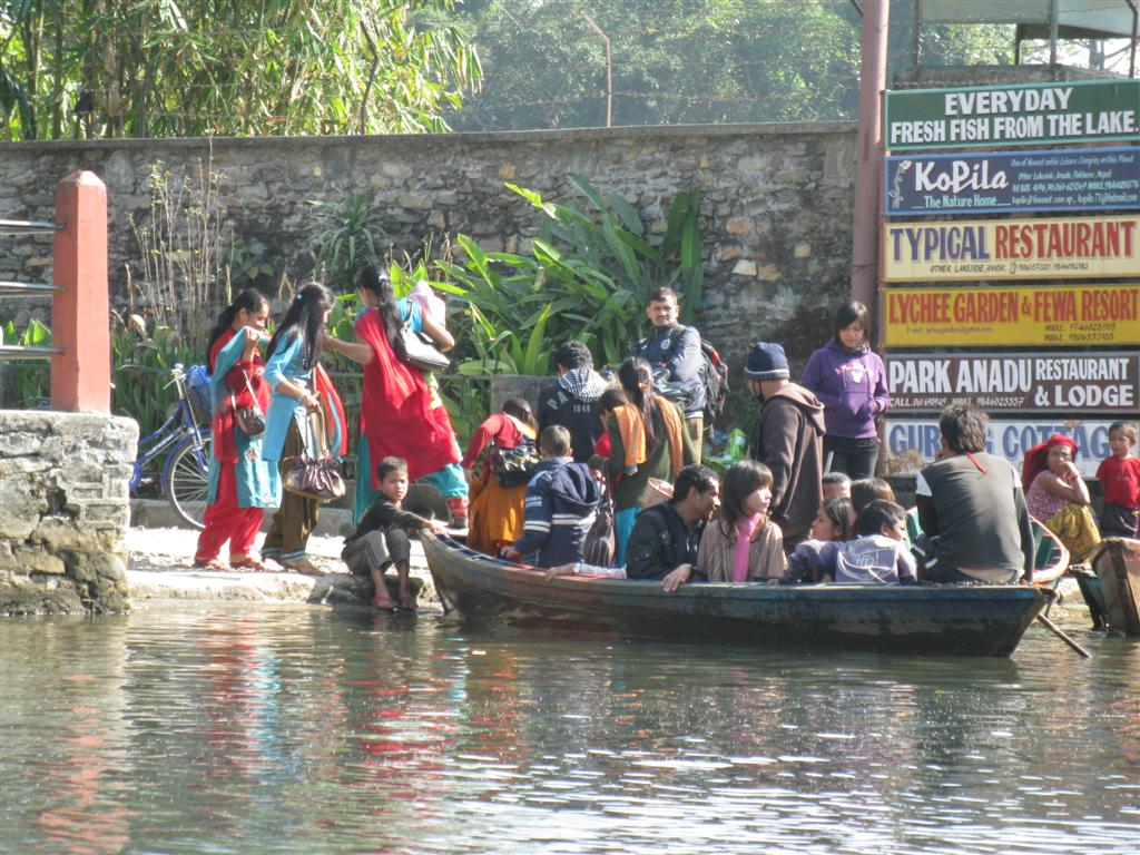 Locals boating to the island's Hindu temple